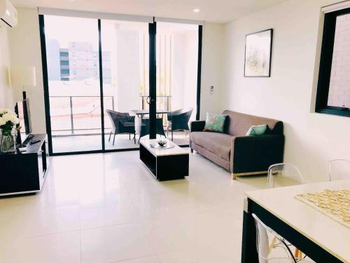 A seating area at 306 1 Bedroom in Kalina Serviced Apartments