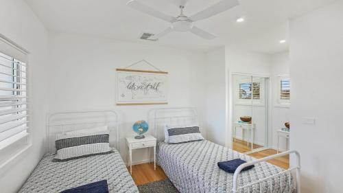 A bed or beds in a room at Kiama Abode - 50 percent off third night on weekend