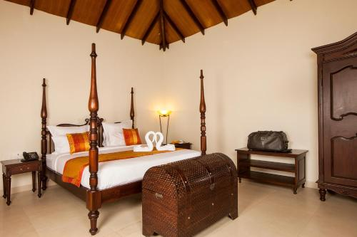 A bed or beds in a room at Old Kent Estates & Spa, Coorg