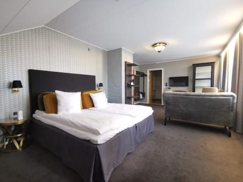 Ein Bett oder Betten in einem Zimmer der Unterkunft Hotel Scheelsminde