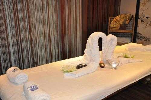 A bed or beds in a room at Aya Maria Wellness SPA Resort