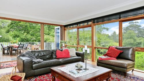 A seating area at Range Haven - country entertainer with tennis court