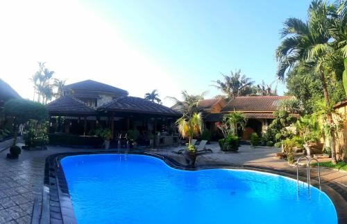 The swimming pool at or near Ndalem Bantul
