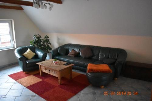 Ein Sitzbereich in der Unterkunft Ferienhaus Harzvorland