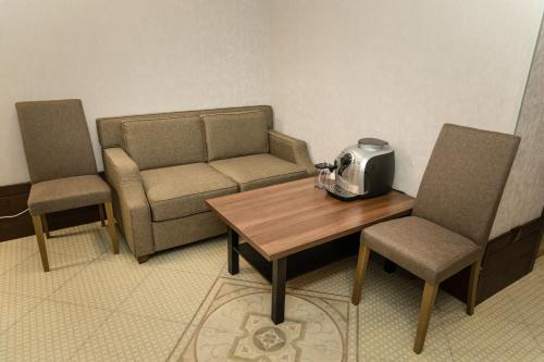 A seating area at Boutique Hotel on Mukomolniy