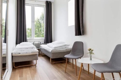 Säng eller sängar i ett rum på Alkoven Logi