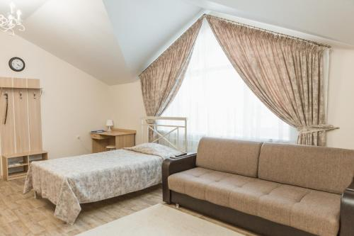 Кровать или кровати в номере Палладиум отель