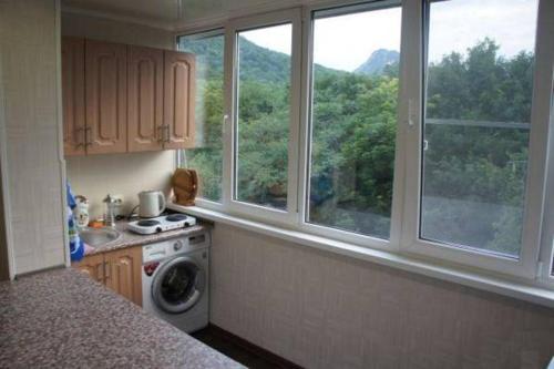 A kitchen or kitchenette at Zheleznovodsk Apartment on Lenina