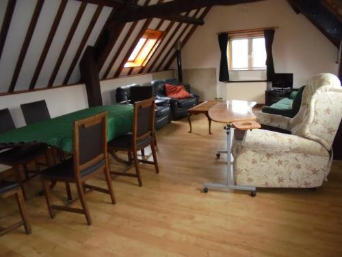 A seating area at West Rew Farm Cottages