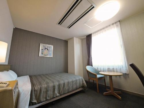 A bed or beds in a room at Hotel Route-Inn Chichibu