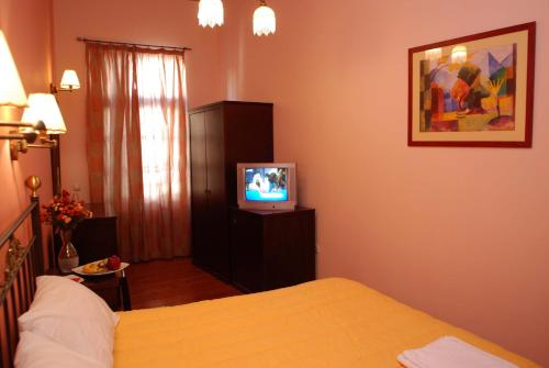 A television and/or entertainment center at Allotino Pension