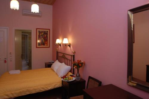 A bed or beds in a room at Allotino Pension