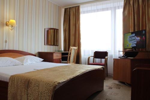 Кровать или кровати в номере Vitebsk Hotel