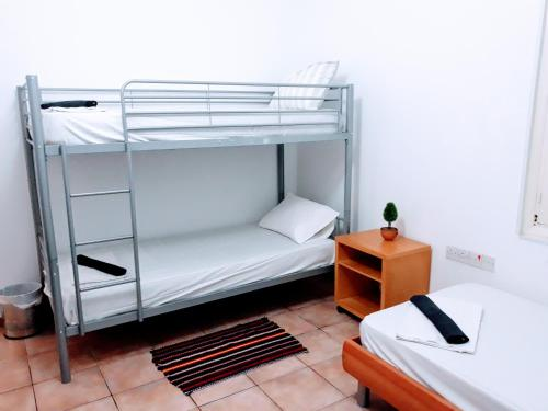 """A bunk bed or bunk beds in a room at Hostel """"Cyprus House"""""""