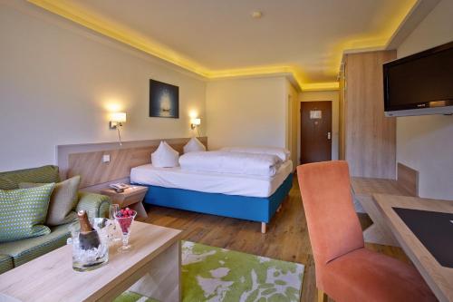 Ein Bett oder Betten in einem Zimmer der Unterkunft Hotel Schloss Berg