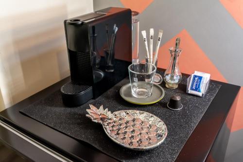 A kitchen or kitchenette at Suíte Camarim