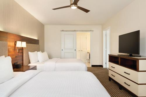 A bed or beds in a room at Homewood Suites By Hilton Augusta