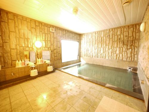 The swimming pool at or near Hotel Route-Inn Jouetsu