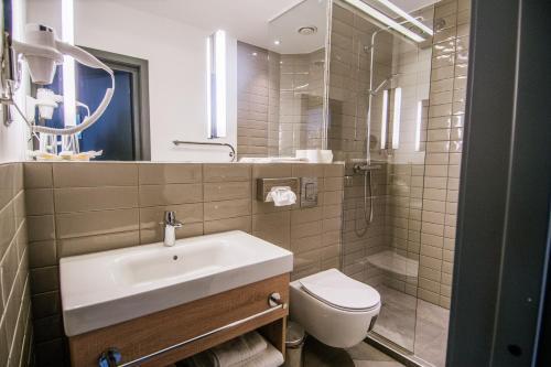 Vonios kambarys apgyvendinimo įstaigoje Royal SPA Residence