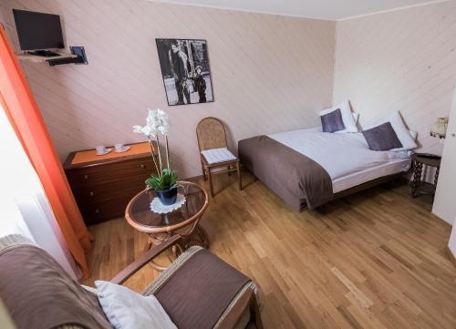Ein Bett oder Betten in einem Zimmer der Unterkunft Hotel de la Place