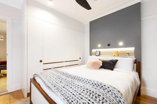 A bed or beds in a room at The Rocks Heritage to Designer Barangaroo Luxury