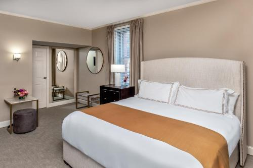 A bed or beds in a room at Portland Regency Hotel & Spa
