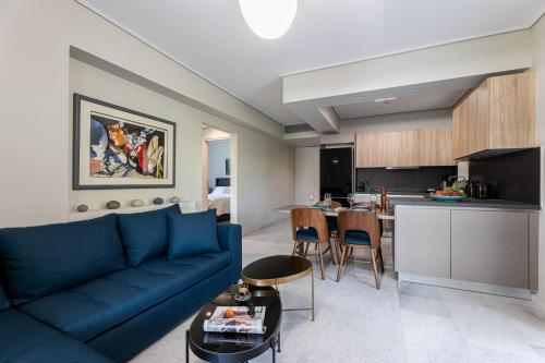 A seating area at Olygreen Athens Residences