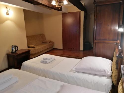 Łóżko lub łóżka w pokoju w obiekcie Gościniec Darłowo & Spa