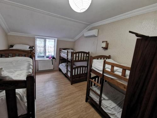 A bunk bed or bunk beds in a room at Rose House