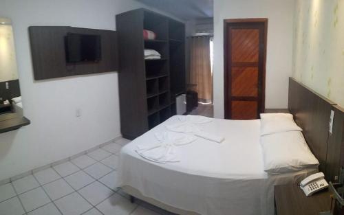 Cama ou camas em um quarto em Termas Park Hotel