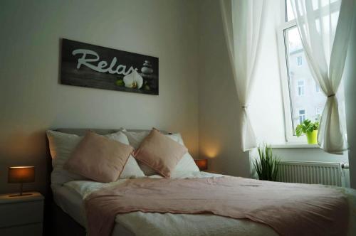 Postel nebo postele na pokoji v ubytování Vienna Apartment Gutarra II