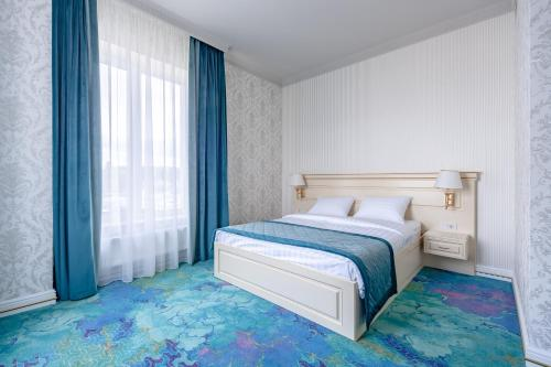 A bed or beds in a room at Hotel Armega Domodedovo
