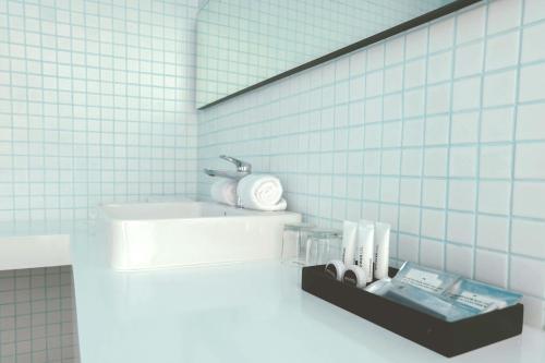 A bathroom at Artotel Gajahmada Semarang
