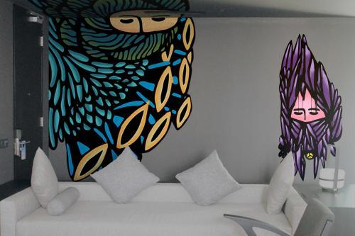 A bed or beds in a room at Artotel Gajahmada Semarang
