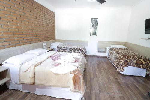 Cama ou camas em um quarto em Hotel Rural Vale das Nascentes