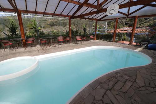A piscina localizada em Hotel Rural Vale das Nascentes ou nos arredores