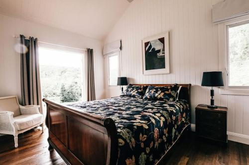 A bed or beds in a room at Nightcap Ridge - Byron Bay Hinterland