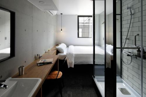 A bed or beds in a room at HOTEL CEN