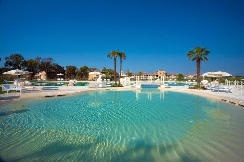 The swimming pool at or near Chervò Golf Hotel Spa, Resort & Apartment San Vigilio