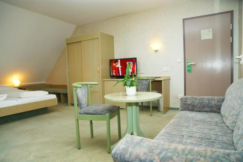 Ein Sitzbereich in der Unterkunft Hotel Krauthof