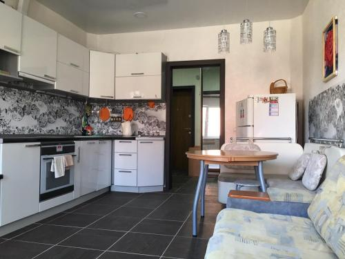 A kitchen or kitchenette at Baikal Apartments