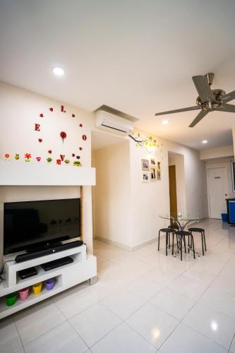 A television and/or entertainment centre at 'A'ffordable Spacius Apartment@Penang