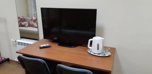 Телевизор и/или развлекательный центр в Antilopa Hostel