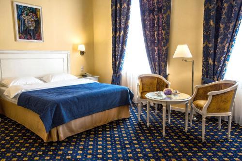 Кровать или кровати в номере Гостиница Волгоград