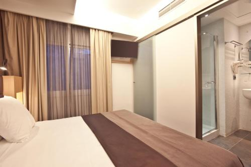 A bed or beds in a room at OD Ocean Drive
