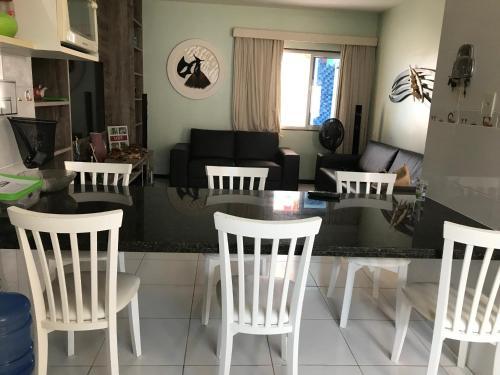 A restaurant or other place to eat at Casa na Barra de São Miguel com diária de Lancha e Cozinheira/arrumadeira