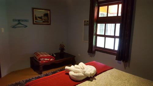 Cama ou camas em um quarto em Pousada Do Moinho