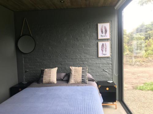 A bed or beds in a room at Exclusiva parcela Olmue en condominio