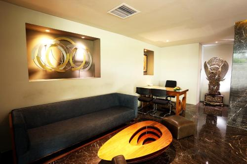 A seating area at AONE Hotel