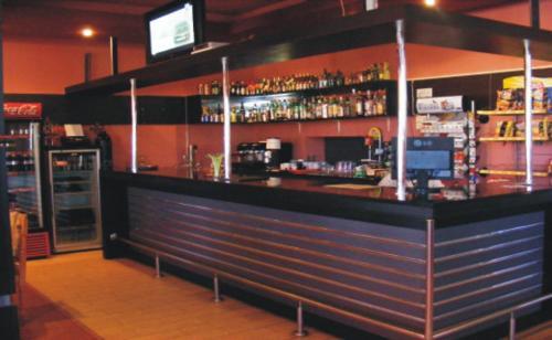 The lounge or bar area at Pensiunea Man President